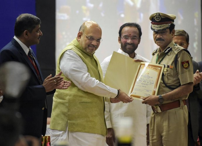 Home Minister Amit Shah presents an award to DCP Sunil Kumar Gautam during the 49th Foundation Day celebrations of BPR&D, at its headquarters, in New Delhi. PTI photo