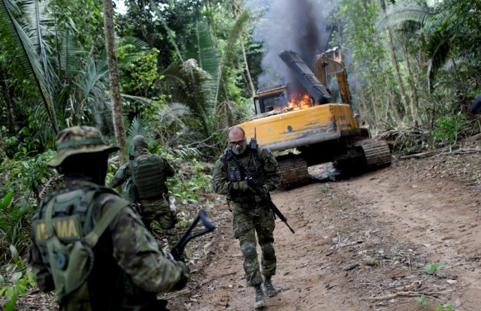 Bolsonaro's environmental policies have come under intense scrutiny in recent days as images of the burning Amazon have sparked international outrage and concern about the consequences for global warming. (Reuters Photo)