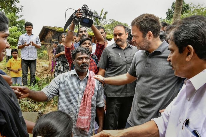 Former Congress president and Wayanad MP Rahul Gandhi interacts with flood victim families at a relief camp at Chaligandha, Payyampally village in Wayanad on Wednesday. PTI photo