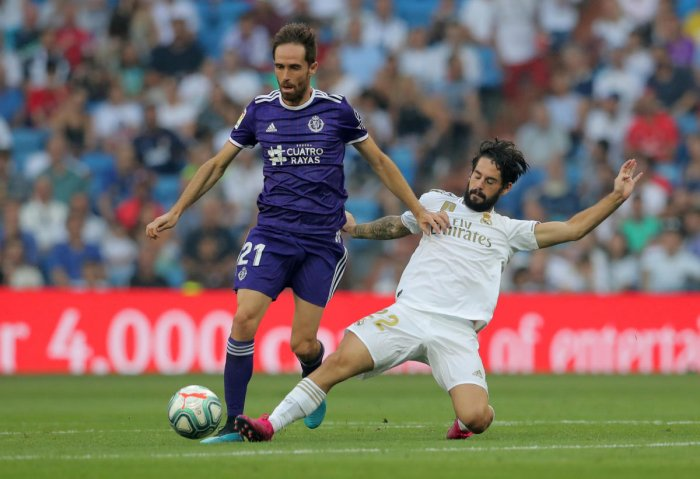 Real Valladolid's Michel in action with Real Madrid's Isco. (Reuters Photo)