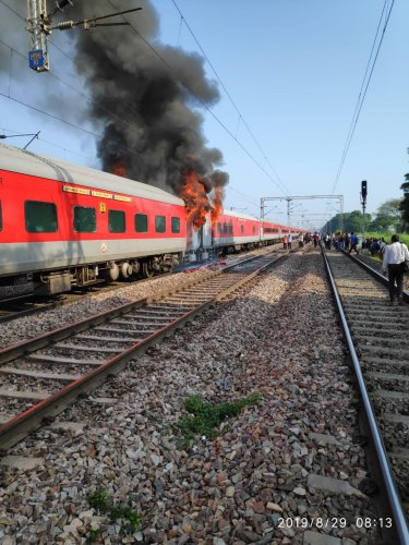 Hyderabad- New Delhi Telangana Express caught fire near Ballabgarh in Haryana on Thursday morning. (DH Photo)