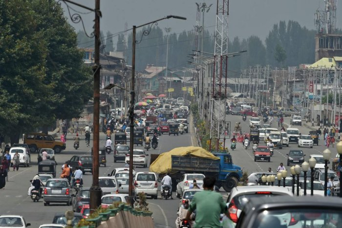 Residents drive along a busy road in Srinagar. AFP file photo