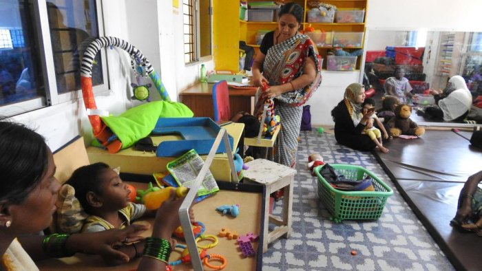Teachers and parents attend to children at Samarthya, an early intervention centre for the differently-abled, in Koppal.