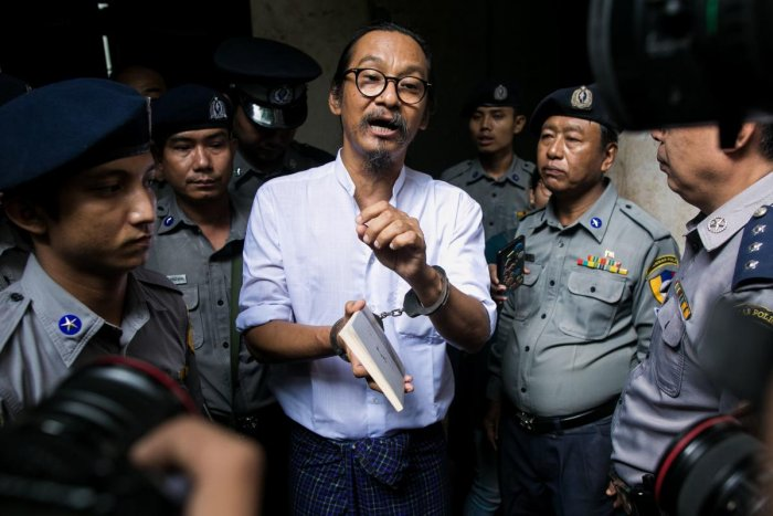 Myanmar human rights activist and film director Min Htin Ko Ko Gyi speaks to journalists after a court verdict in Yangon on August 29, 2019. (AFP)
