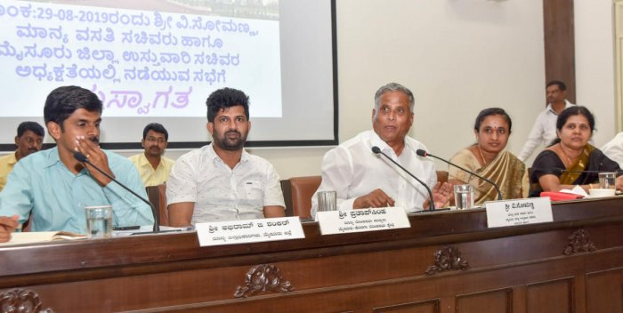 District in-charge Minister V Somanna addresses district-level officials during Dasara-related meeting at Zilla Panchayat in Mysuru on Thursday. Deputy Commissioner Abhiram G Sankar, MP Pratap Simha, ZP President Parimala Shyam and vice president M V Gowr