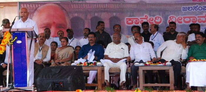 Chief Minister B S Yediyurappa speaks at a programme, after offering bagina, at KRS dam, in Srirangapatna taluk, Mandya district, on Thursday.