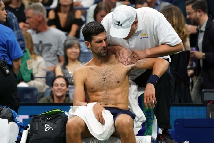 Novak Djokovic of Serbia receives treatment between games against Juan Ignacio Londero of Argentina during their Round Two Men's Singles match at the 2019 US Open. Photo/AFP