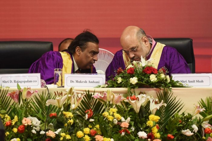 Home Minister Amit Shah and chairman of Pandit Dindayal Petroleum University and businessman Mukesh Ambani (L) during 7th Convocation Ceremony at the PDPU campus in Gandhinagar on Thursday. AFP