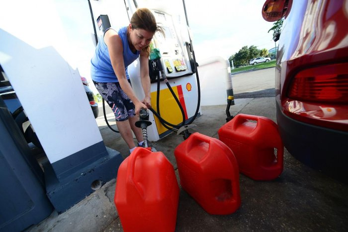 A resident fills gas cans in preparation for Hurricane Dorian on August 29, 2019 in Winter Springs, Florida. Gerardo Mora/Getty Images/AFP