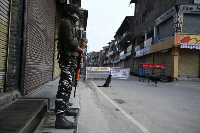 An Indian government forces personnel stands guard as they block a road during a lock down in Srinagar. AFP photo