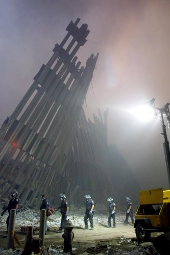 In this file photo taken on September 11, 2001, firefighters make their way through the rubble of the World Trade Center in New York after two hijacked planes flew into the landmark skyscrapers. AFP file photo