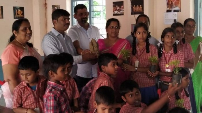 Members of Eco Friends Group distributed clay Ganesha idols and saplings to the schoolchildren of Zilla Panchayat Higher Primary School at Kadri.