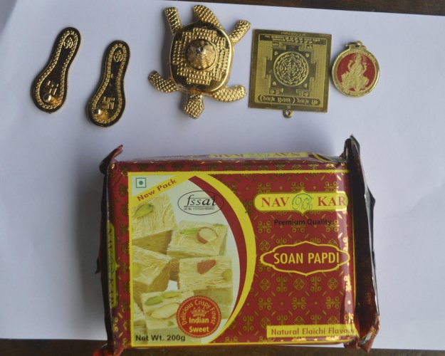 The materials received by Sharavana of Suntikoppa through courier instead of a mobile phone.