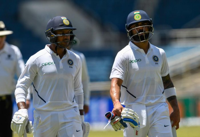Agarwal and Kohli scored crucial fifties to take India to a competitive total on Day 1 (AFP Photo)