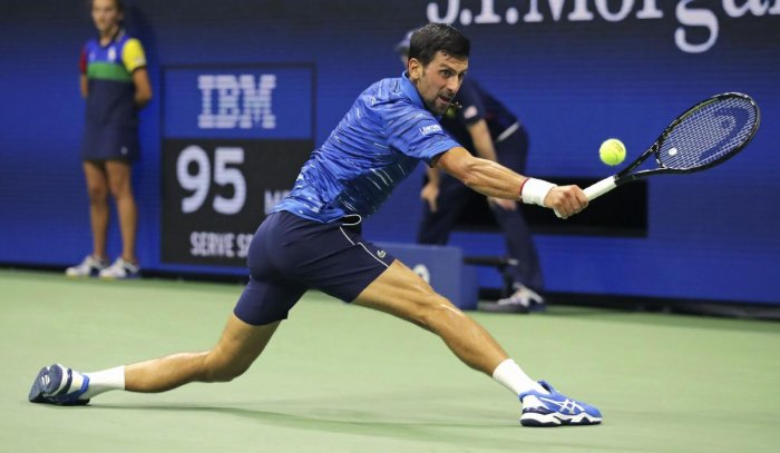 Novak Djokovic, of Serbia, stretches for a return to Denis Kudla during the third round of the U.S. Open tennis championship. (PTI Photo)