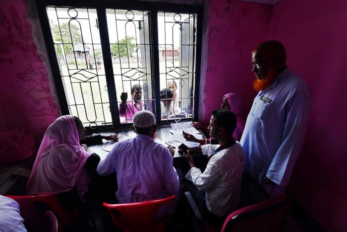 People check their names on the final list of the National Register of Citizens (NRC) in an office in Pavakati village of Morigoan district, some 70 kms from Guwahati, Assam. AFP photo
