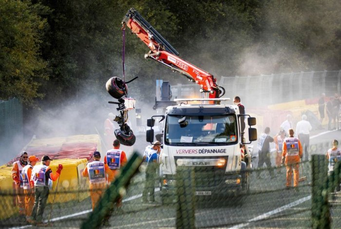 Juan Manuel Correa's crashed car remains being cleared at the Spa-Francorchamps in Belgium. Picture credit: AFP