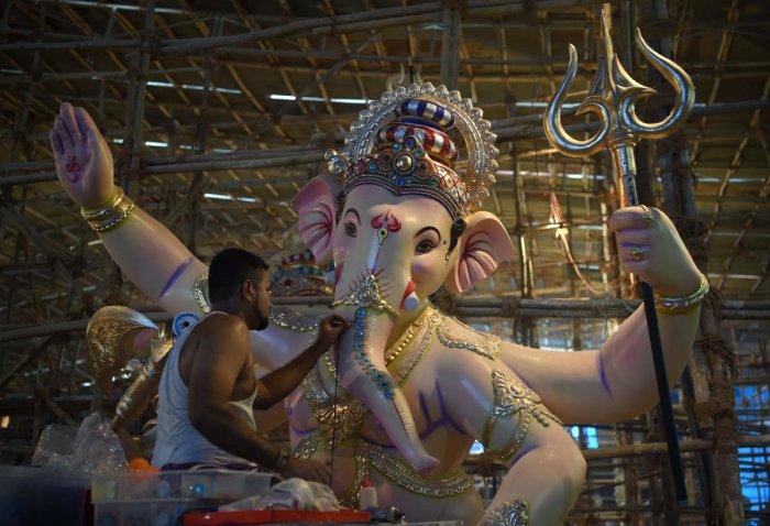 An artisan works on an idol of the elephant-headed Hindu god Lord Ganesha at a workshop ahead of the Ganesh Chaturthi festival in Mumbai. AFP photo