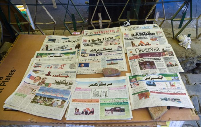 Newspaper obits have become the only means by which Kashmir residents become aware of the deaths of their near and dear ones amid a communication blockade. AFP File Photo