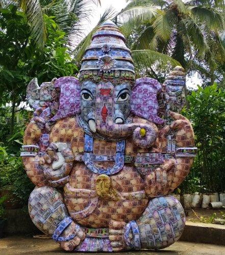 A Ganesha idol made from artificial currencies of 21 countries displayed at Sai Radha Motors on Vidya Samudra Road, Udupi.