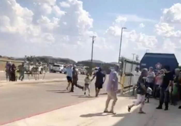 People are evacuated from Cinergy Odessa cinema following a shooting in Odessa, Texas, U.S. in this still image taken from a social media video August 31, 2019. Rick Lobo via REUTERS