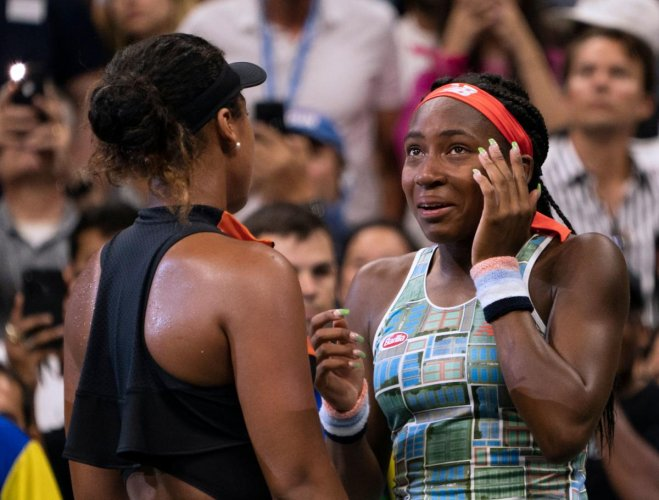 Naomi Osaka (L) of Japan comforts Coco Gauff of the US after the former thrashed her opponent in a third-round match. AFP Photo