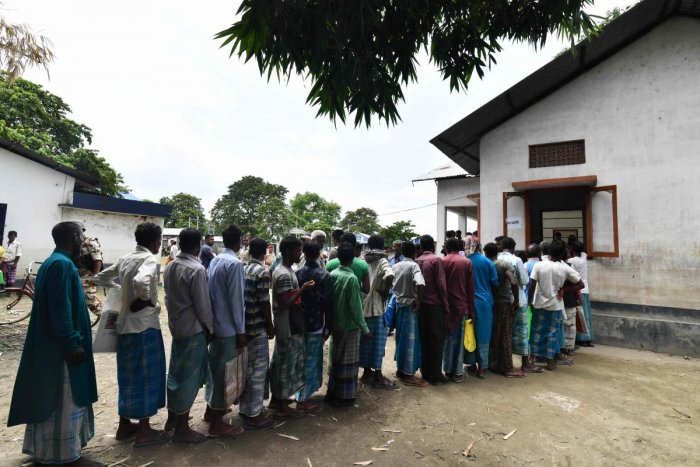 People stand in a queue to check their names on the final list of the National Register of Citizens (NRC) in an office in Pavakati village of Morigoan district, Assam. AFP file photo
