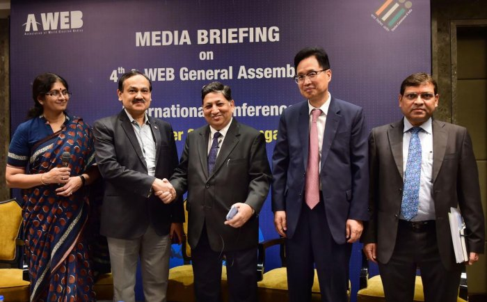 Deputy EC Umesh Sinha shakes hands with Karnataka State EC Sanjiv Kumar ahead of the 4th General Assembly meeting of A-WEB and International Conference, in Bengaluru, Sunday, Sept 01, 2019. (PTI Photo)