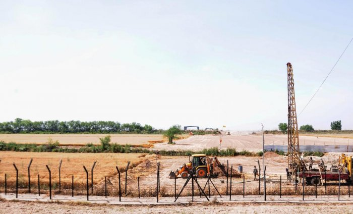 Heavy machines at work beyond the border fence for the construction of the Indian side of Kartarpur corridor, in Gurdaspur district. (PTI Photo)