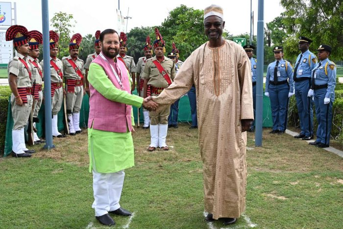 Ibrahim Thiaw (R), executive secretary of the United Nations Convention to Combat Desertification (UNCCD) and Prakash Javadekar, Indian minister of Environment, Forest and Climate Change shake hands after the flag hosting ceremony during the 14th meeting