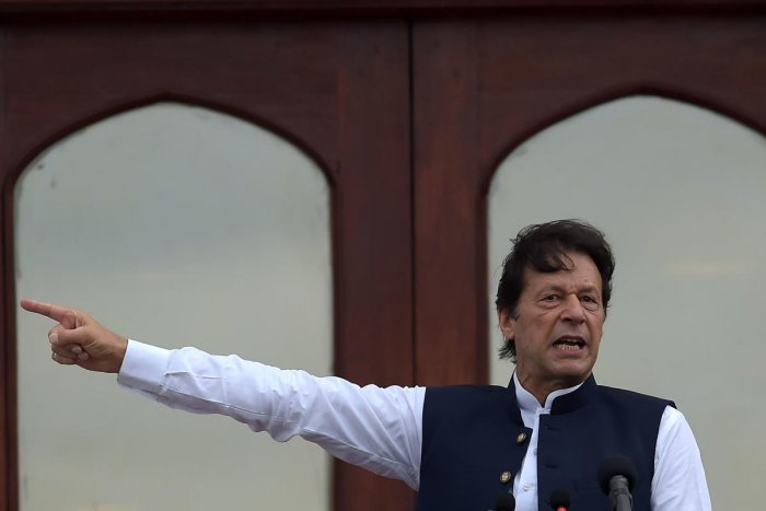 Pakistan's Prime Minister Imran Khan addresses the nation outside the Prime Minister Secretariat building in Islamabad. (Photo by AFP)