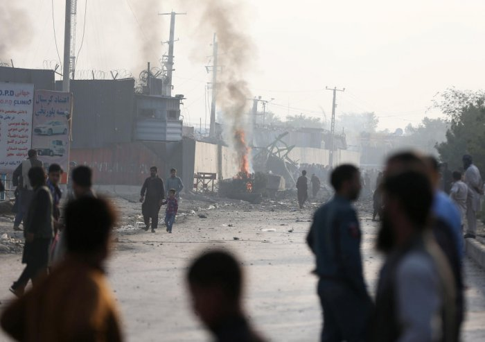 Angry Afghan protesters burn tires and shout slogans at the site of a blast in Kabul, Afghanistan September 3, 2019. (REUTERS)