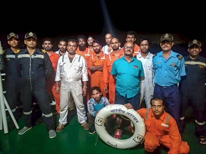 Indian Coast Guard personnel rescued at least 13 persons onboard dredger Tridevi Prem after it reported flooding, off Mangaluru. (PTI photo)