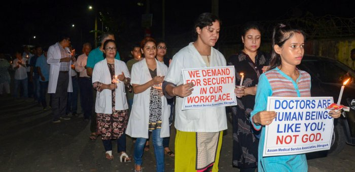 Assam Medical College & Hospital Teachers Association and the Assam wing of the Indian Medical Association (IMA) take out a candle protest rally against the alleged assault on a senior doctor Deben Dutta (73), in Dibrugarh. PTI photo