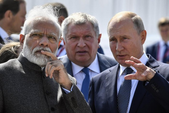 Russian President Vladimir Putin, right, and Indian Prime Minister Narendra Modi, left, talk to each other as they visit shipyard Zvezda. (AP/PTI photo)