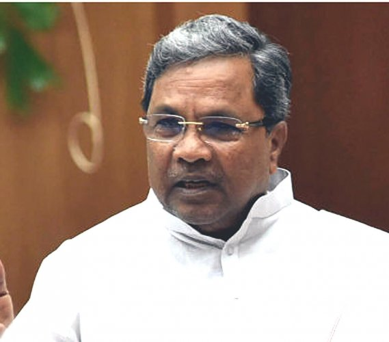We have asked our party workers to stage protests peacefully, Siddaramaiah told media persons here on Thursday, on his way to Badami. (DH File Photo)