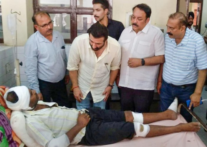 Actor and local BJP MP Sunny Deol visits an injured victim of the Batala fireworks factory blast, at the civil hospital in Gurdaspur district of Punjab, Thursday, Sept 5, 2019. (PTI Photo)
