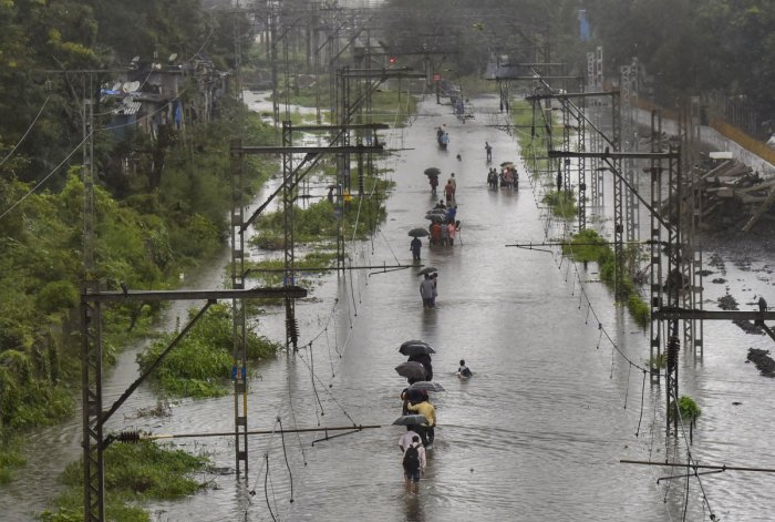 People living adjacent to salt pans near the Vasai Road station were badly affected as flood water entered their houses.PTI