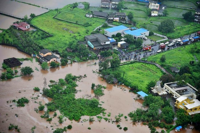 An aerial view of a flooded area following heavy monsoon rains,taken and released by the Indian Navy. Photo credit: AFP