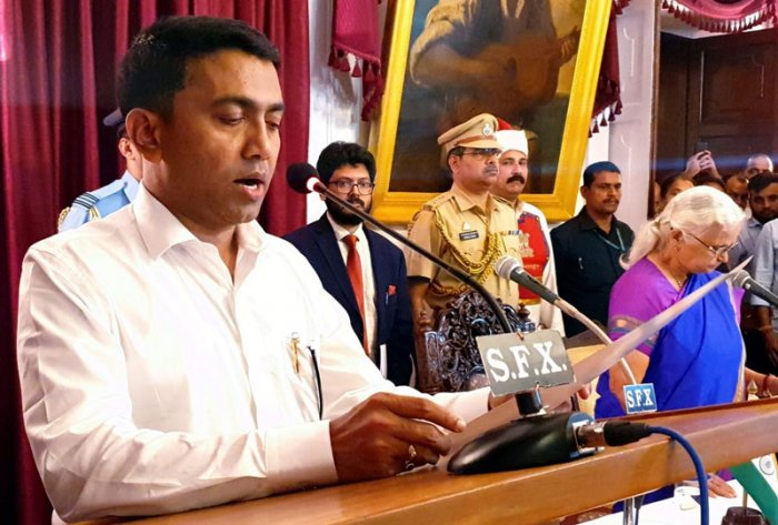 """""""Whatever I am today is because of Manohar bhai... he was my idol... I became an MLA because of him, I became a Speaker because of him,"""" Sawant said after he was sworn in as chief minister by Governor Mridula Sinha at a post-midnight ceremony at the Raj Bhawan. (PTI Photo)"""