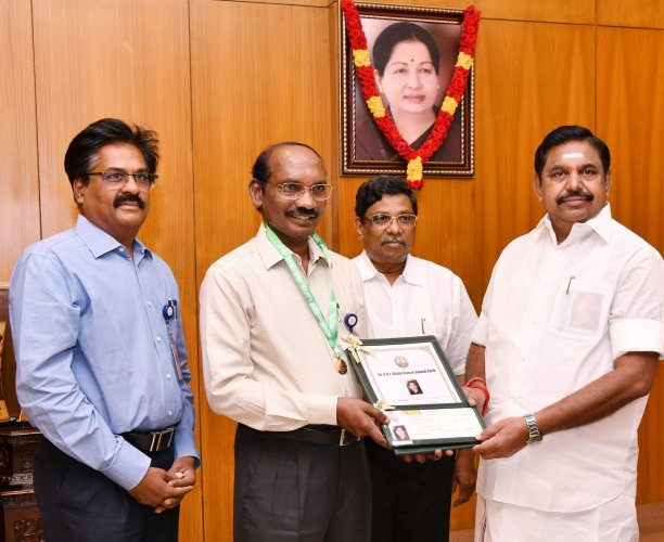 Isro chief Dr K Sivan receiving Dr A P J Abdul Kalam award for scientific growth from Tamil Nadu Chief Minister Edappadi K Palaniswami here on Thursday. DH Photo