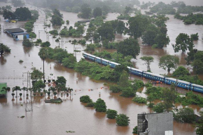 An aerial view shows a stranded Mahalaxmi Express near Badlapur in Thane district of Maharashtra on Saturday. REUTERS