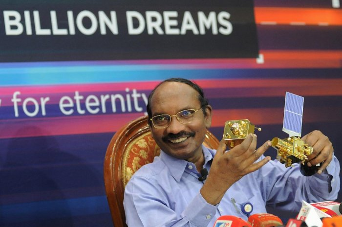 Indian Space Research Organisation (ISRO) Chairman Kailasavadivoo Sivan holds up a model of the Chandrayaan-2 spacecraft during a press conference at the ISRO headquarters in Bangalore on August 20, 2019. (Photo by Manjunath Kiran / AFP)