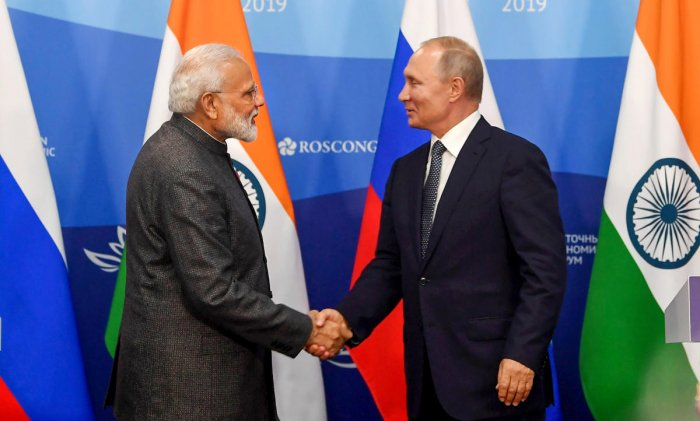 Prime Minister Narendra Modi shakes hands with President of Russian Federation Vladimir Putin during the joint press statements, at Vladivostok, in Russia, Wednesday, Sept 4, 2019. (PIB/PTI Photo)