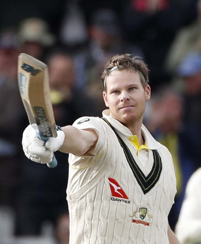 Australia's Steve Smith raises his bat after scoring 200 runs during day two of the fourth Ashes Test cricket match between England and Australia at Old Trafford in Manchester, England. (AP/PTI Photo)