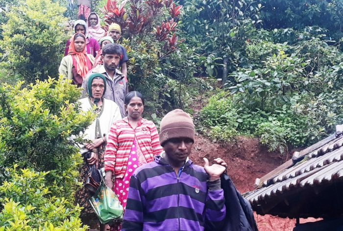 Residents of Chennahadlu in Chikkamagaluru district moving to safer areas following landslides.