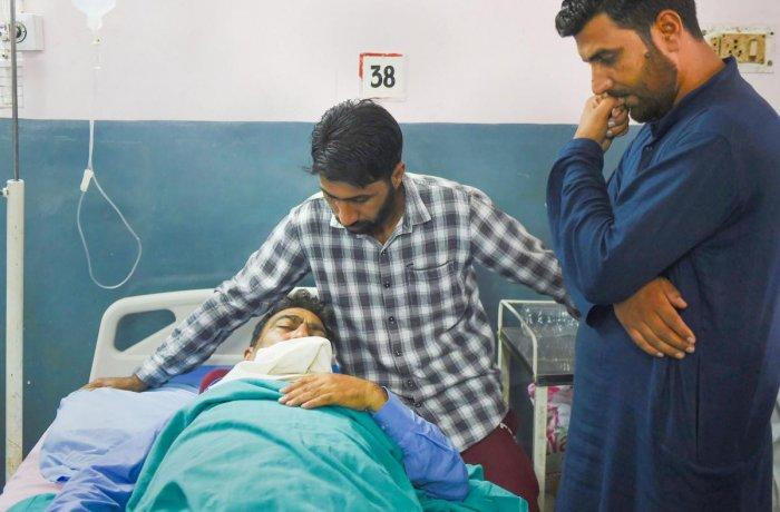 An injured fruit dealer Mohammad Ashraf Dar undergoing treatment at a hospital, in Srinagar, Saturday, Sept. 7, 2019. (PTI Photo)