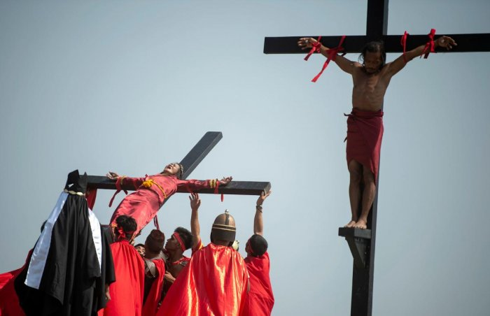 Philippine Christian devotees are nailed to crosses during a reenactment of the Crucifixion of Christ during Good Friday ahead of Easter in the village of Cutud near San Fernando. (AFP File Photo)