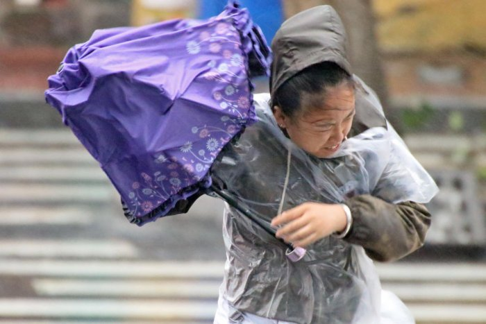 A woman holds an umbrella against the wind and rainfall brought by Typhoon. Reuters file photo for representation