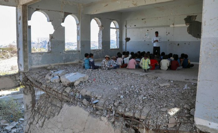 Yemeni children attend class on the first day of the new academic year in the country's third-city of Taez on September 3, 2019, at a school that was damaged last year in an air strike. AFP Photo